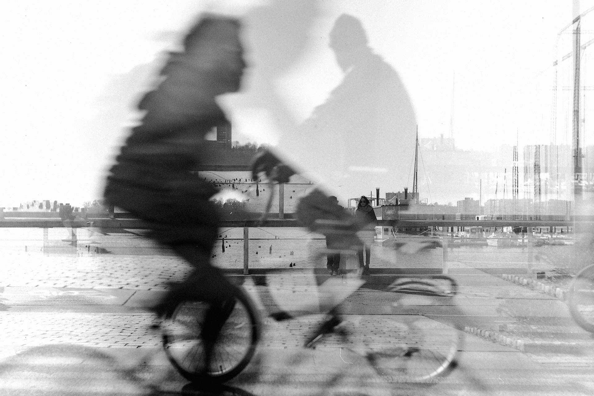 Double exposed photo of bicyclists